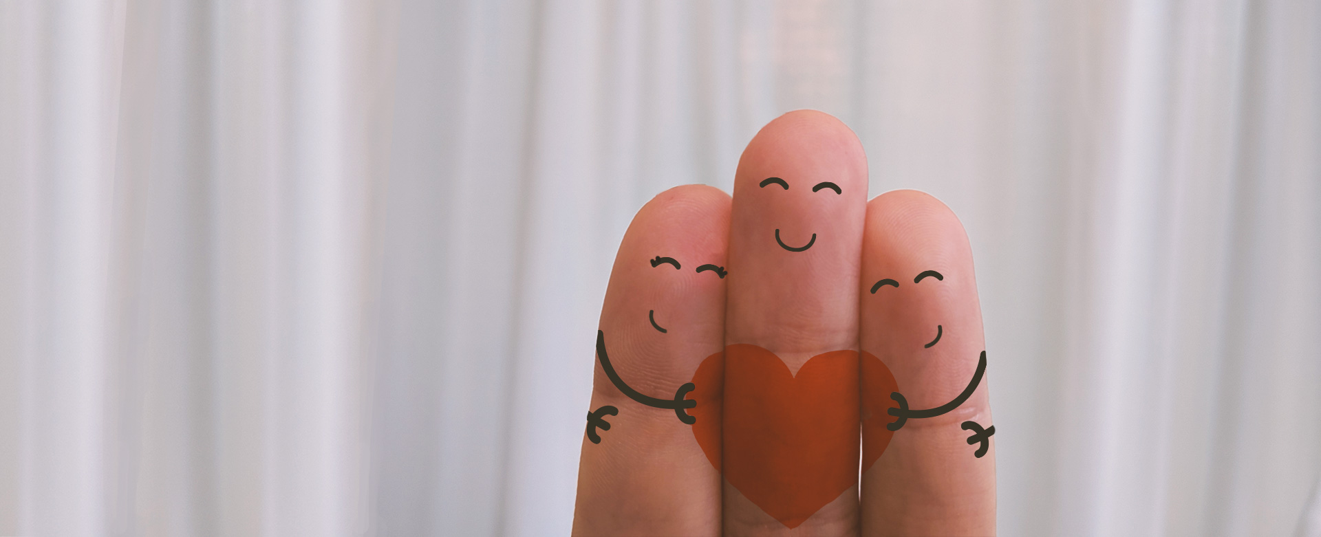 Three fingers hugging with heart