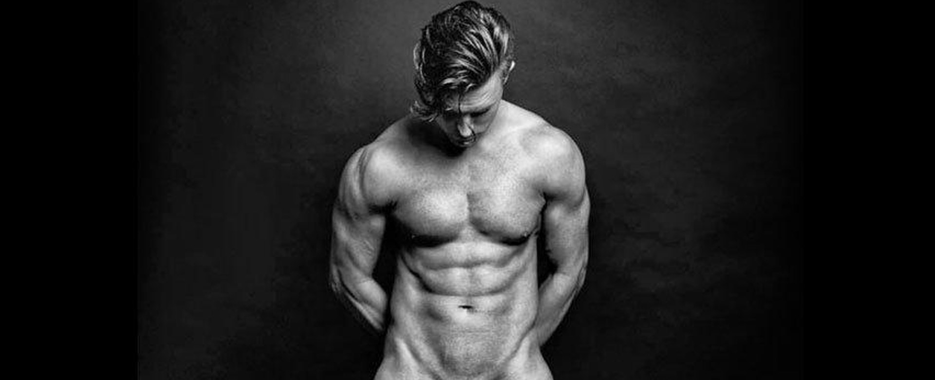 Naked upper body of man looking down