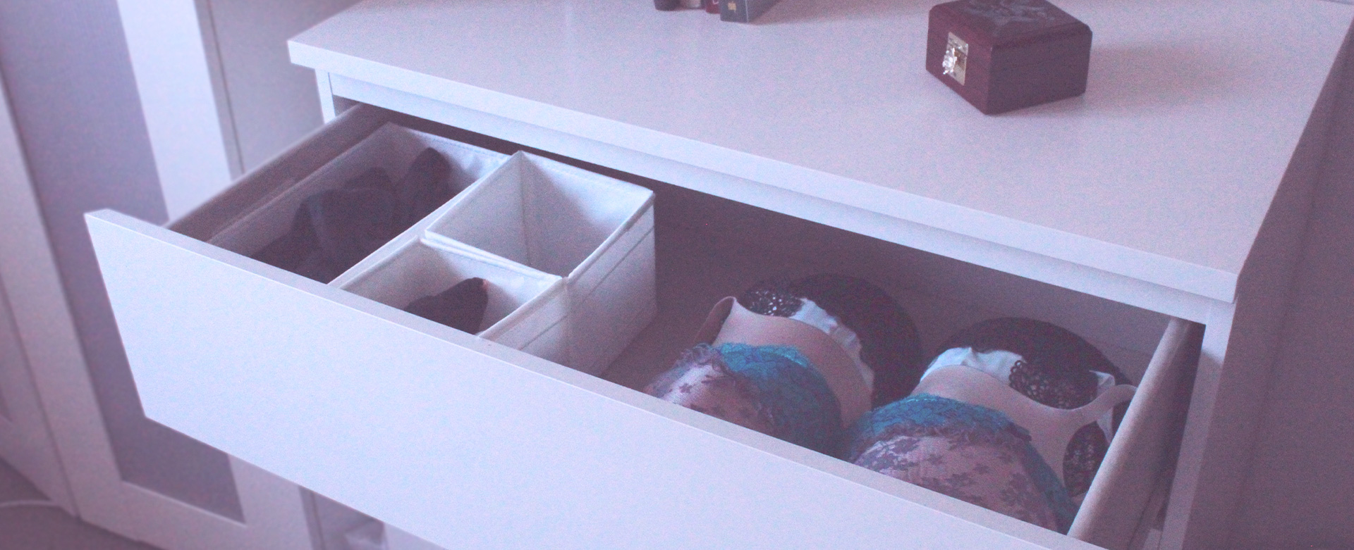 An open lingerie drawer showing a range of beautiful bras