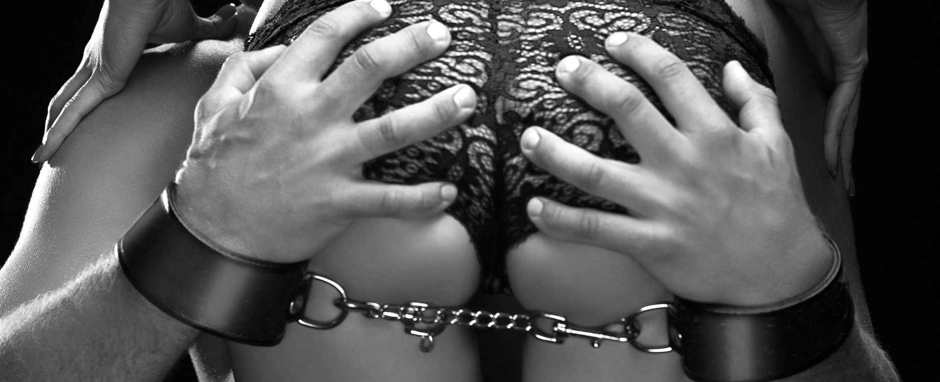 MAn in handcuffs gripping a woman's bottom