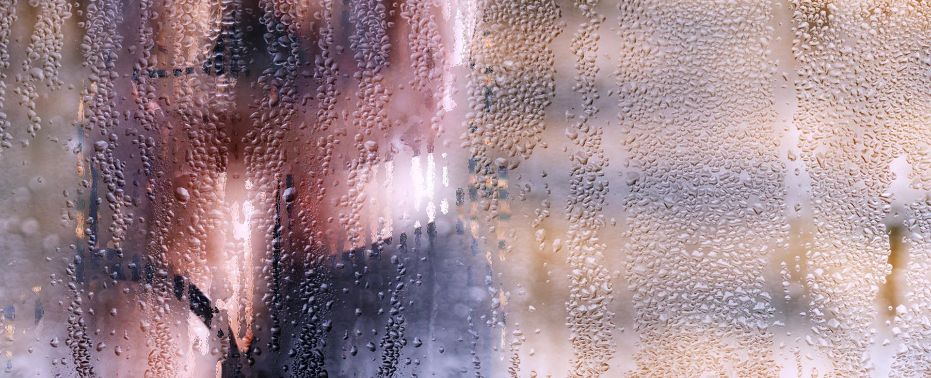 Couple in embrace behind a shower door